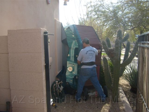 Az Spa and Hot Tub Movers removing a spa through a narrow gate way